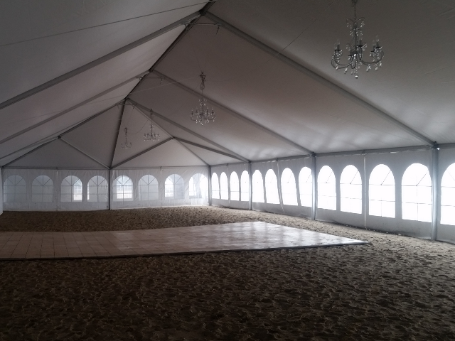 inside of a 40 ft. x 100 ft. Aztec Jumbotrac Frame Tent on a Lake Erie beach