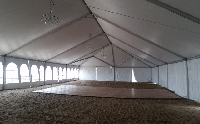 inside a 40 ft. x 100 ft. frame tent on a Lake Erie beach
