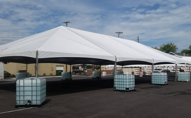 40 ft. x 80 ft. frame tent anchored with water totes