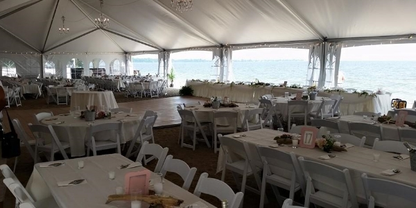 inside 40x100 frame tent fro wedding reception on Lake Erie beach