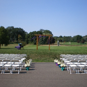 white wood chair and wedding arch at Valleywood Golf Club