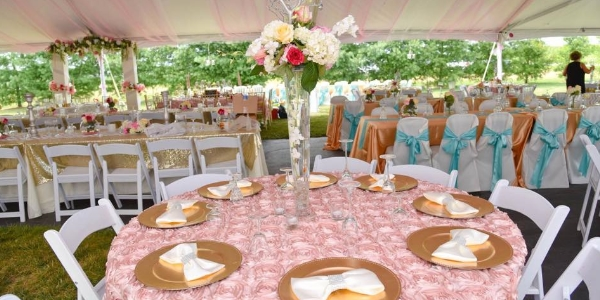 table setting under a 40x120 frame tent