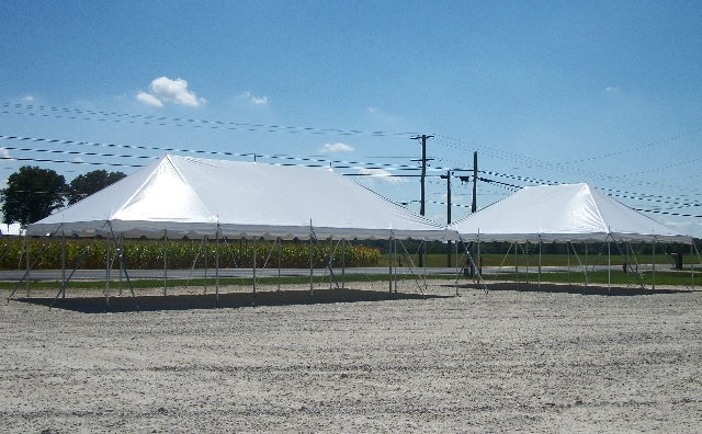 20 ft. x 40 ft. and 20 ft. x 30 ft. Classic Poles Tents in Stone Parking Lot