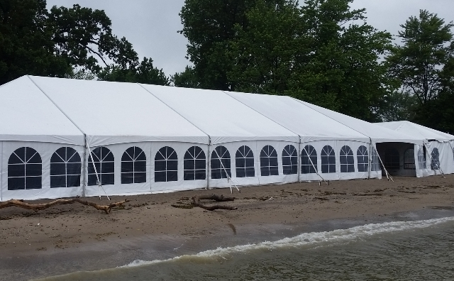 40 ft. x 100 ft. Aztec Jumbotrac Frame Tent on a beach of Lake Erie